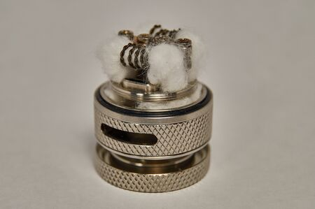 Replace cotton and reel the coil on RTA vape.