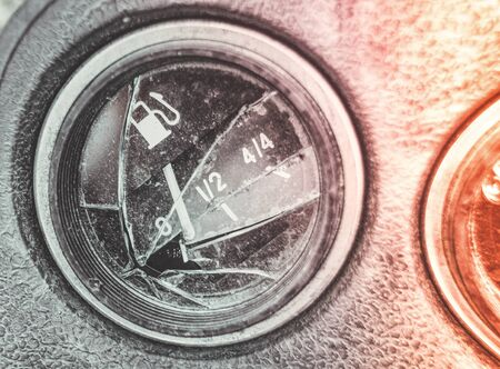 broken car panel, the pointer of the fuel gauge at zero. close up