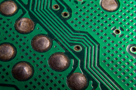 dusty printed circuit Board with components. macro. 免版税图像