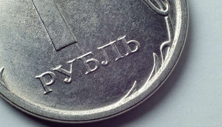 One Russian Ruble coin with Ruble lettering.
