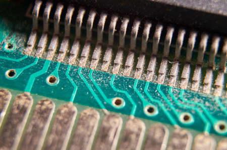 dusty printed circuit Board with components. macro. selective focus