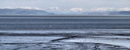 mud and snow: Morcambe Bay Stock Photo