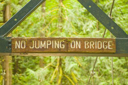 no jumping on bridge sign Reklamní fotografie