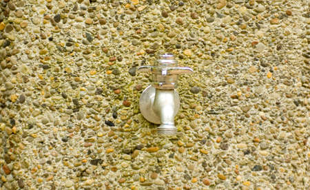 spout: Silver water spout with knob on pebbles stand