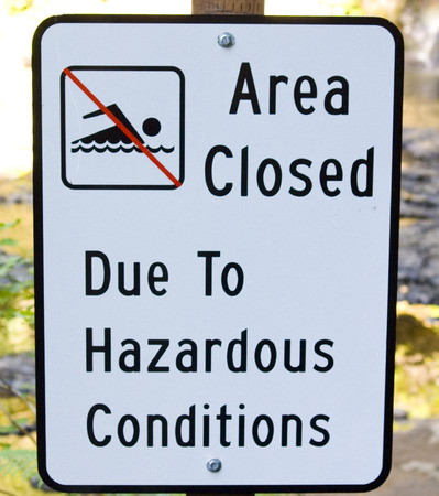 Area Closed to swimming sign for hazard