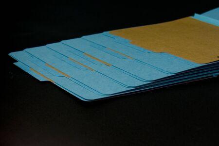 Blue file folders open on black background Reklamní fotografie