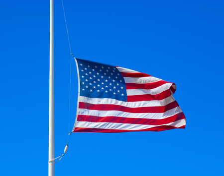 United states flag flying at half staff Stock Photo