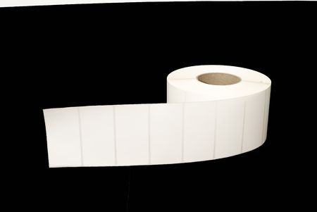 label: Roll of white labels on black background