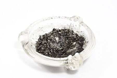 Glass ash tray with ashes 版權商用圖片