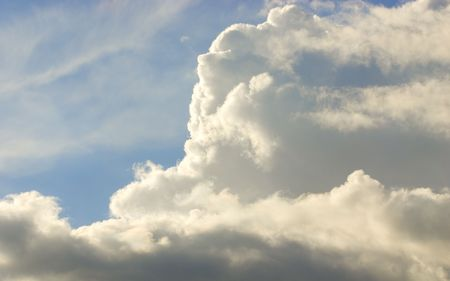 Sun shining on clouds with blue sky