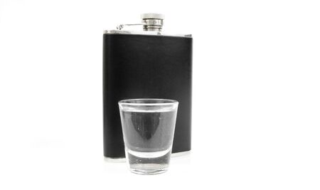 shot glass and flask on white Stock Photo