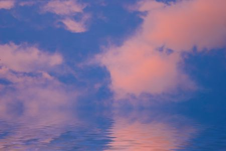 pink clouds with blue sky and water Stock Photo