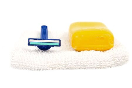 clothe: soap and razor on white clothe Stock Photo