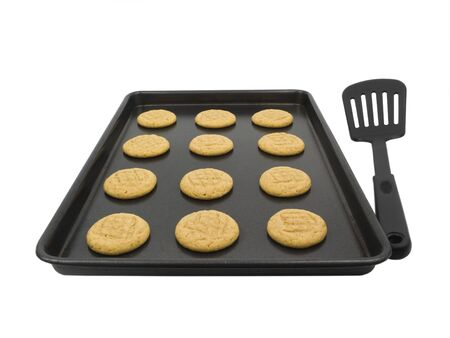Peanut butter cookies on baking pan with spatula Imagens - 4600781