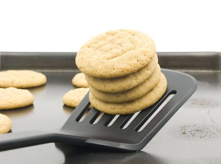 Peanut butter cooking stacked on spatula