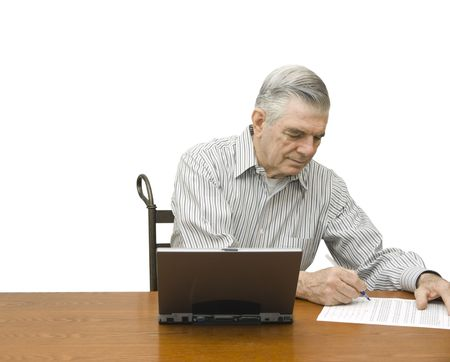 person writing: Senior writing with laptop on a white background