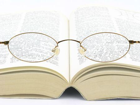 Eye glasses over book improving vision to see better Zdjęcie Seryjne