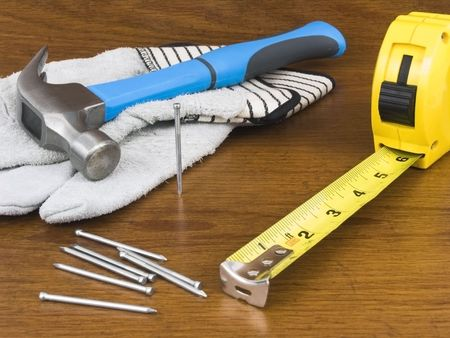 Many tools laying on a wooden background