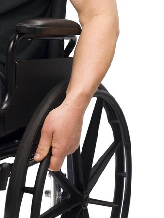Wheel chair: Hand on wheel chair with white background