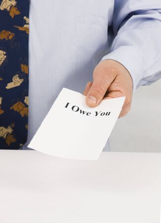 owe: Man handing a paper with I owe you on it