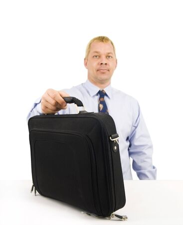 Business man setting down briefcase on white background