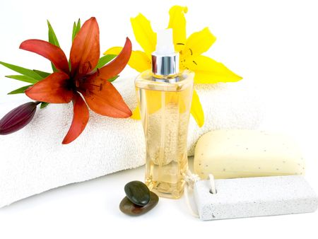 Spa setting with perfume rocks and flowers on a white background Banco de Imagens
