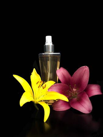 Perfume with lillies on a black background