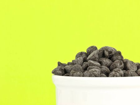 semisweet: Chocolate chips on green background with copy space