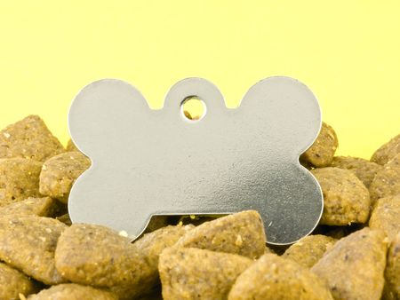 kibble: Blank Dog Tag in Kibble on a Yellow Background