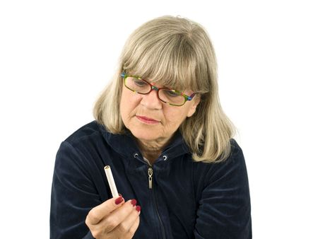 Senior Woman Contimplating smoking on white background