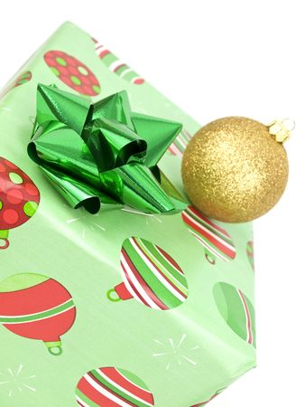 Close up of present with bauble on white background