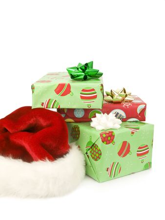 Presents with Santa hat on a white background Imagens