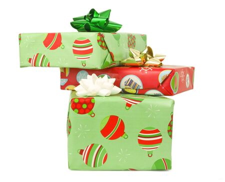 Wrapped presents stacked on a white background Imagens