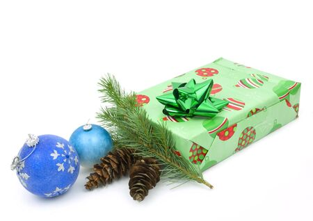Christmas ornaments and present on white background