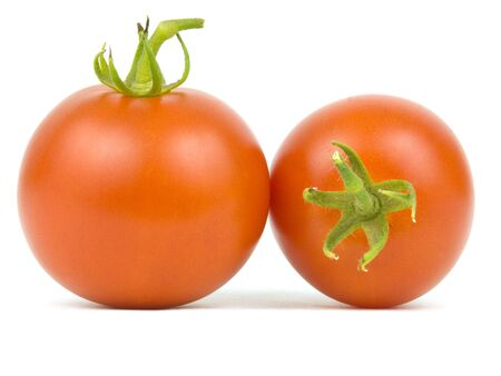 Two ripe tomatoes on a white background photo