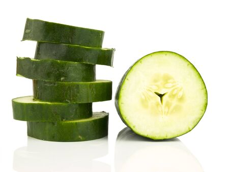 ingrediant: Green Cucumber sliced on a white background Stock Photo