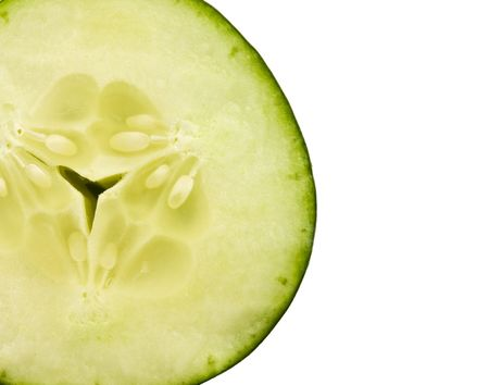 Close up of a cucumber slice on a white background