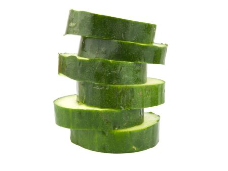Green Cucumber sliced on a white background Imagens