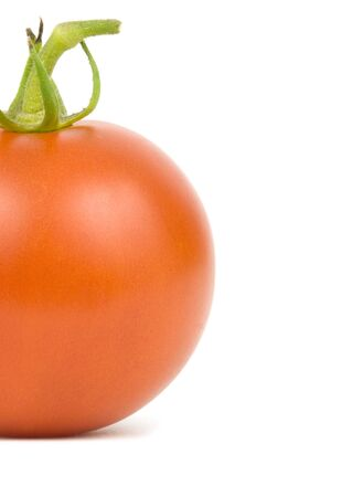Single ripe tomato on a white background Imagens