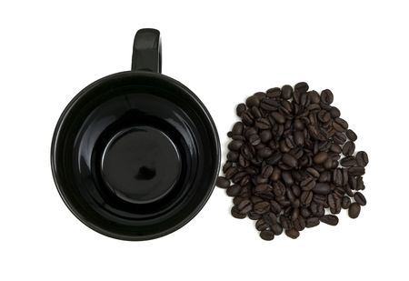 Aerial view of a black mug and coffee beans