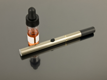 glycol: Electronic Cigarette with e-juice on silver background