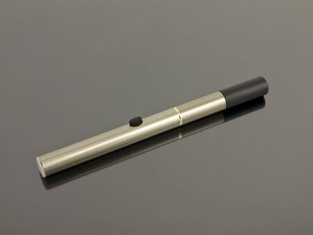 Electronic Cigarette with reflection on a silver background