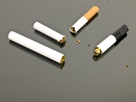 electronic: Electronic cigarette and an analog cigarette on a silver background