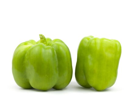 two green bell peppers on a white background Imagens