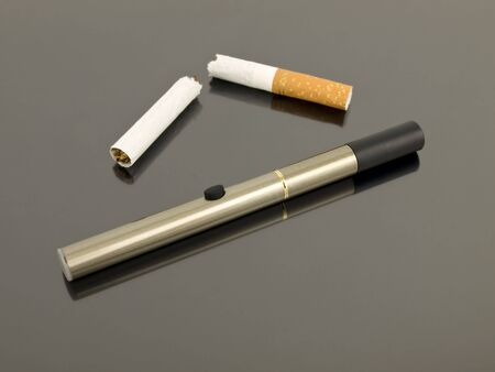 Electronic cigarette with broken analog cigarette Stock Photo - 5745112