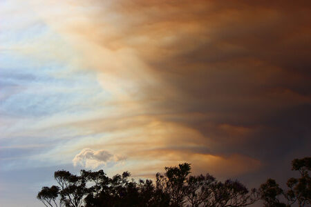 Clouds during a bushfire engulfing the clear blue sky