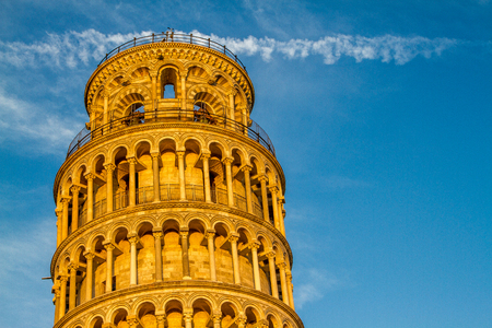 Close-up of the Leaning Tower of Pisa at sunrise