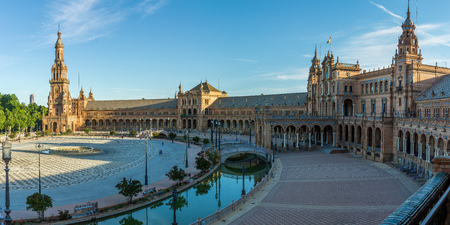A panorama just after sunrise of the Plaza de España (translated to Spain Square) which is found in the Parque de Maria Luisa in Seville, Andalucia in Southern Spain.
