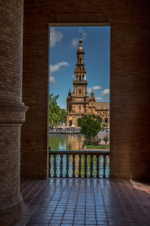 a look through one of the archways at the Plaza de Espana, Seville, towards one of the towers Фото со стока