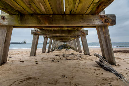 Morning at Blyth beach, with the old wooden Pier stretching out to the North Sea, taken from underneath